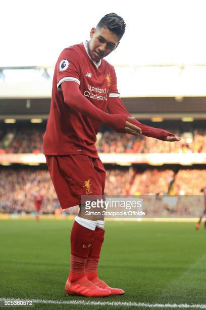 Roberto Firmino of Liverpool celebrates after scoring their 3rd goal during the Premier League match between Liverpool and West Ham United at Anfield...