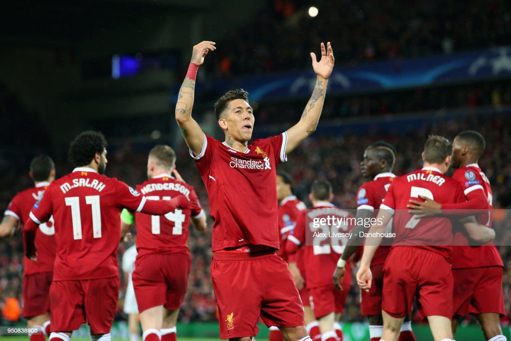 Roberto Firmino of Liverpool celebrates after scoring their fifth goal during the UEFA Champions League Semi Final First Leg match between Liverpool and A.S. Roma at Anfield on April 24, 2018 in Liverpool, United Kingdom.