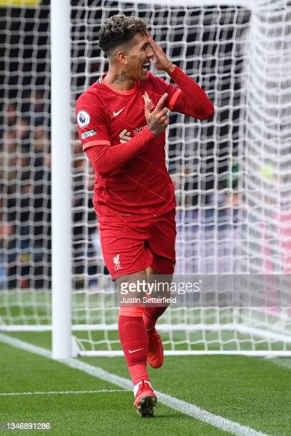 Roberto Firmino of Liverpool celebrates after scoring their side's third goal during the Premier League match between Watford and Liverpool at...