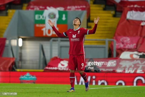 Roberto Firmino of Liverpool celebrates after scoring their team's third goal during the Premier League match between Liverpool and Leicester City at...