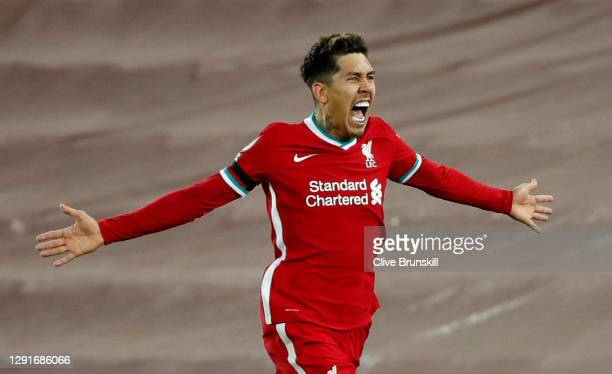 Roberto Firmino of Liverpool celebrates after scoring their team's second goal during the Premier League match between Liverpool and Tottenham...