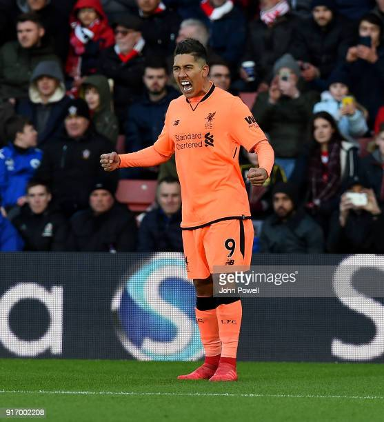 Roberto Firmino of Liverpool celebrates after the scoring the opening goal during the Premier League match between Southampton and Liverpool at St...