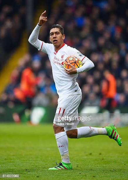 Roberto Firmino of Liverpool celebrates as he scores their first and equalising goal during the Barclays Premier League match between Crystal Palace...