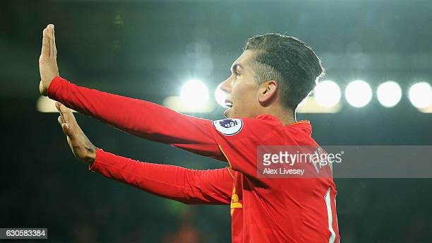 Roberto Firmino of Liverpool celebrates as he scores their second goal during the Premier League match between Liverpool and Stoke City at Anfield on...