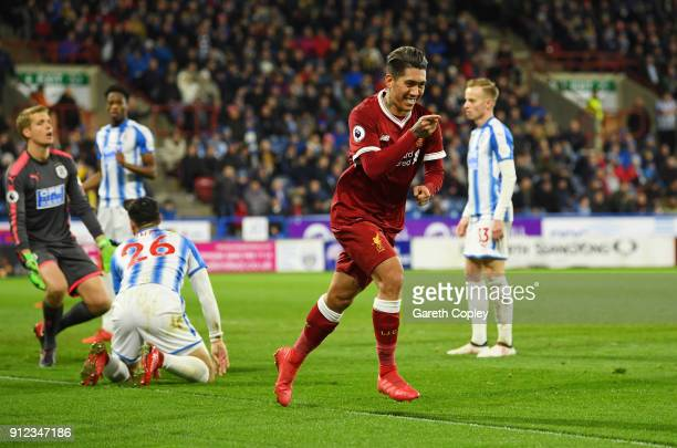 Roberto Firmino of Liverpool celebrates as he scores their second goal past goalkeeper Jonas Lossl of Huddersfield Town during the Premier League...