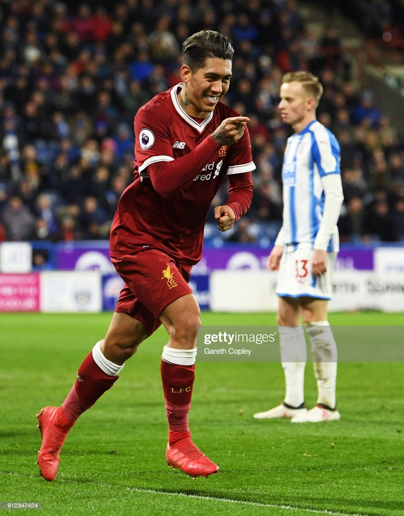 Roberto Firmino of Liverpool celebrates as he scores their second goal during the Premier League match between Huddersfield Town and Liverpool at John Smith's Stadium on January 30, 2018 in Huddersfield, England.