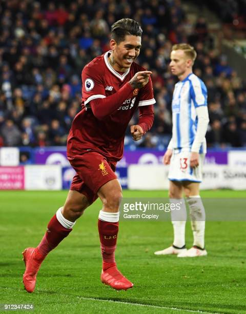 Roberto Firmino of Liverpool celebrates as he scores their second goal during the Premier League match between Huddersfield Town and Liverpool at...