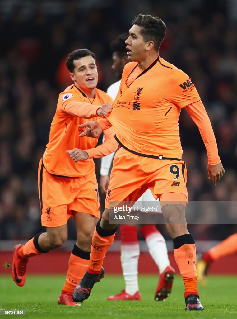 Roberto Firmino of Liverpool (9) celebrates as he with Philippe Coutinho scores their third goal during the Premier League match between Arsenal and Liverpool at Emirates Stadium on December 22, 2017 in London, England.
