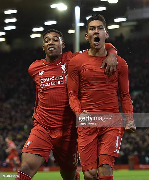 Roberto Firmino of Liverpool celebrates his first goal with Jordan Ibe of Liverpool during the Barclays Premier League match between Liverpool and...