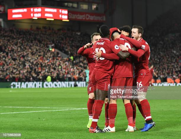 Roberto Firmino of Liverpool celebrates his first goal with team mates Xherdan Shaqiri Sadio Mane Mohamed Salah and Andrew Robertson during the...