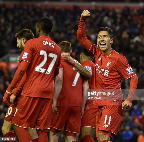 Roberto Firmino of Liverpool celebrates his goal during the Barclays Premier League match between Liverpool and Manchester City at Anfield on March 2...