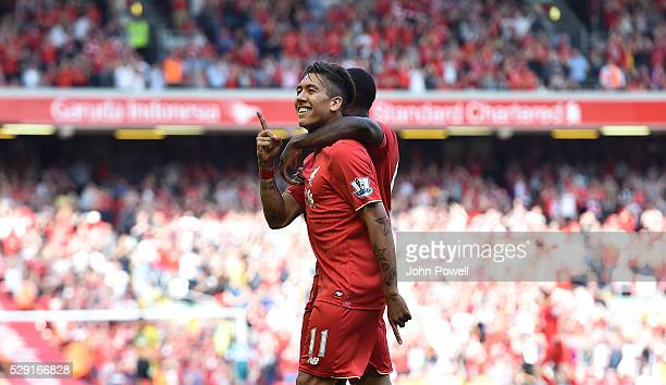 Roberto Firmino of Liverpool celebrates his goal during the Barclays Premier League match between Liverpool and Watford at Anfield on May 08 2016 in...