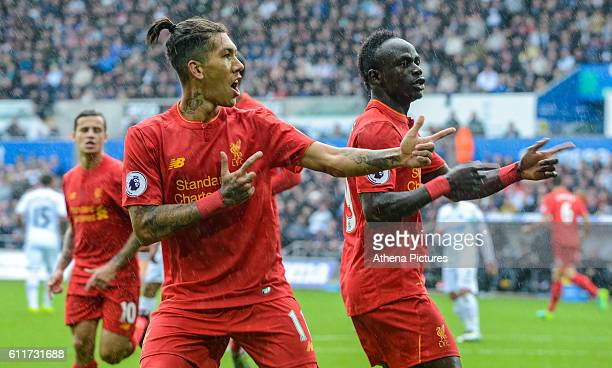 Roberto Firmino of Liverpool Celebrates his goal during the Premier League match between Swansea City and Liverpool at The Liberty Stadium on October...