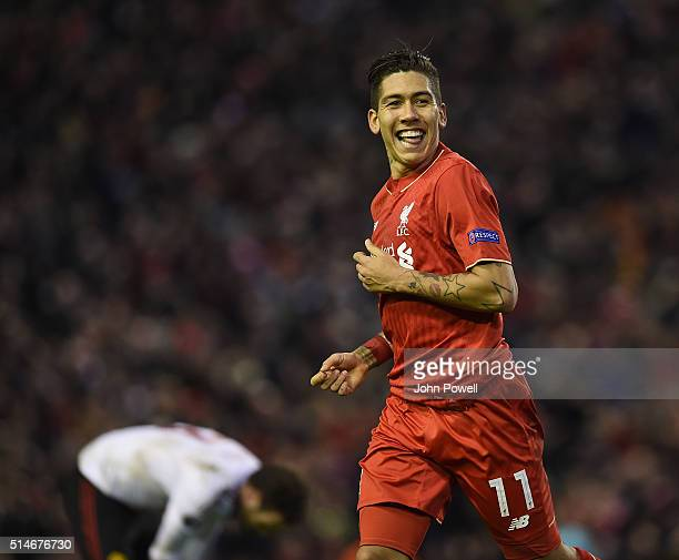 Roberto Firmino of Liverpool celebrates his goal during the UEFA Europa League Round of 16 first leg match between Liverpool and Manchester United on...