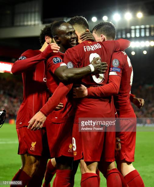 Roberto Firmino of Liverpool celebrates his goal with team mates Mohamed Salah, Sadio Mane and Andy Robertson during the UEFA Champions League round...