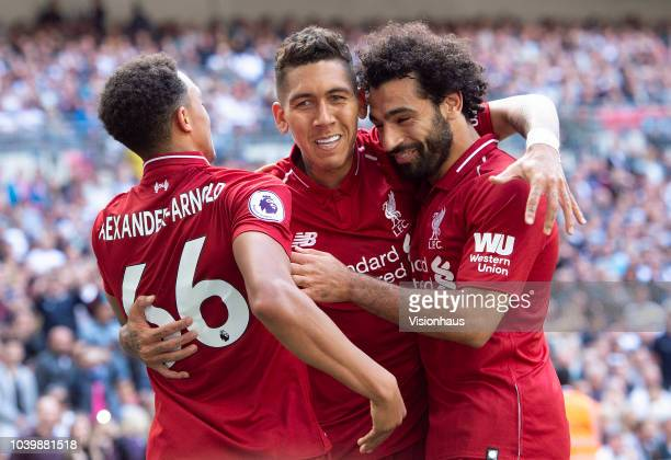 Roberto Firmino of Liverpool celebrates his goal with Trent AlexanderArnold and Mohamed Salah during the Premier League match between Tottenham...
