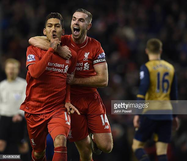 Roberto Firmino of Liverpool celebrates his second goal with Jordan Henderson of Liverpool during the Barclays Premier League match between Liverpool...