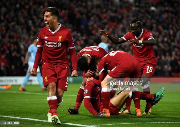 Roberto Firmino of Liverpool celebrates his sides first goal after Mohamed Salah of Liverpool scores during the UEFA Champions League Quarter Final...
