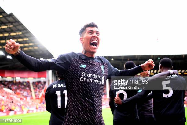 Roberto Firmino of Liverpool celebrates his team's first goal during the Premier League match between Sheffield United and Liverpool FC at Bramall...