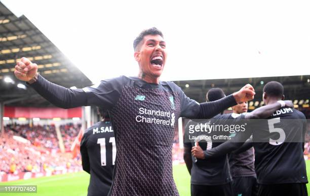 Roberto Firmino of Liverpool celebrates his team's first goal scored by Georginio Wijnaldum during the Premier League match between Sheffield United...
