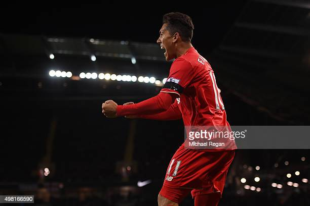 Roberto Firmino of Liverpool celebrates his team's first goal scored by Eliaquim Mangala of Manchester City during the Barclays Premier League match...