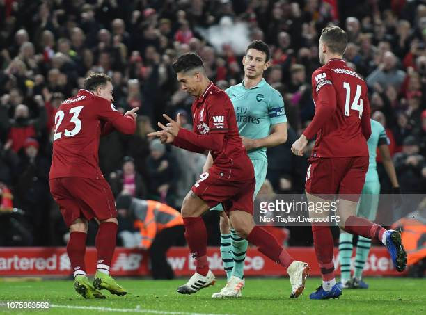 Roberto Firmino of Liverpool celebrates his third goal with team mate Xherdan Shaqiri during the Premier League match between Liverpool FC and...