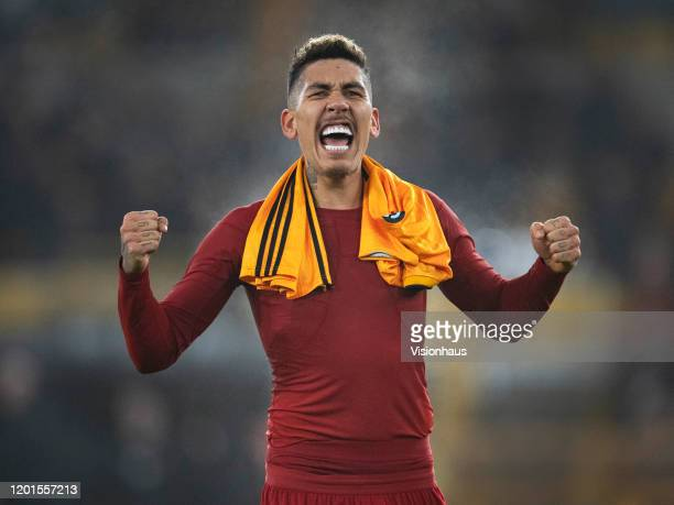 Roberto Firmino of Liverpool celebrates in front of thefans after during the Premier League match between Wolverhampton Wanderers and Liverpool FC at...