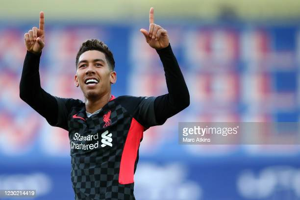 Roberto Firmino of Liverpool celebrates scoring his first goal during the Premier League match between Crystal Palace and Liverpool at Selhurst Park...