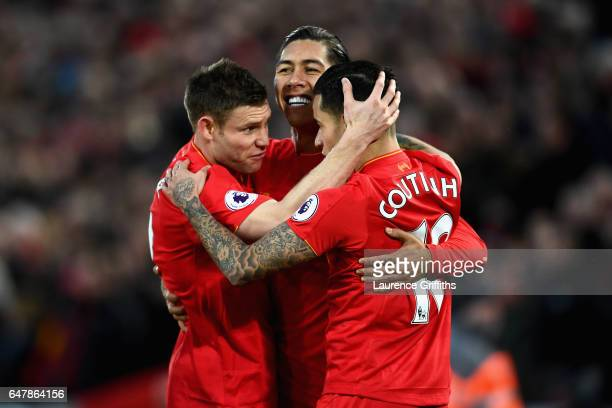 Roberto Firmino of Liverpool celebrates scoring his sides first goal with James Milner of Liverpool and Philippe Coutinho of Liverpool during the...