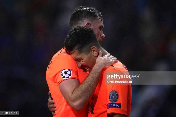 Roberto Firmino of Liverpool celebrates scoring his side's fourth goal with teammate Jordan Henderson during the UEFA Champions League Round of 16...