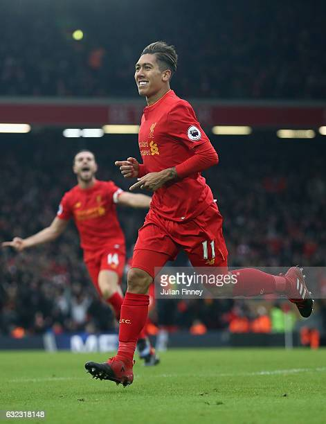 Roberto Firmino of Liverpool celebrates scoring his sides second goal during the Premier League match between Liverpool and Swansea City at Anfield...