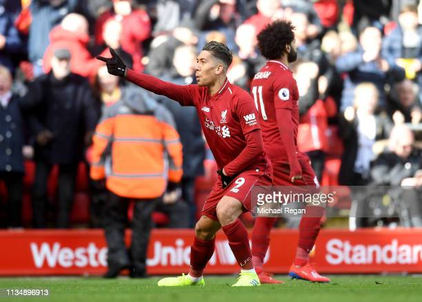 Roberto Firmino of Liverpool celebrates scoring his sides third goal during the Premier League match between Liverpool FC and Burnley FC at Anfield...