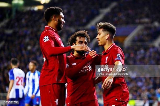 Roberto Firmino of Liverpool celebrates scoring his sides third goal during the UEFA Champions League Quarter Final second leg match between Porto...
