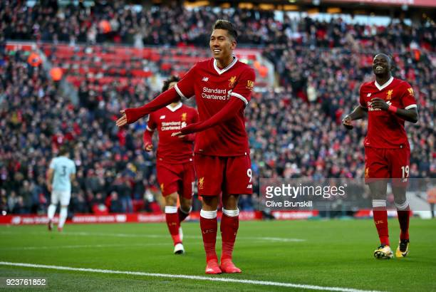 Roberto Firmino of Liverpool celebrates scoring his side's third goal during the Premier League match between Liverpool and West Ham United at...