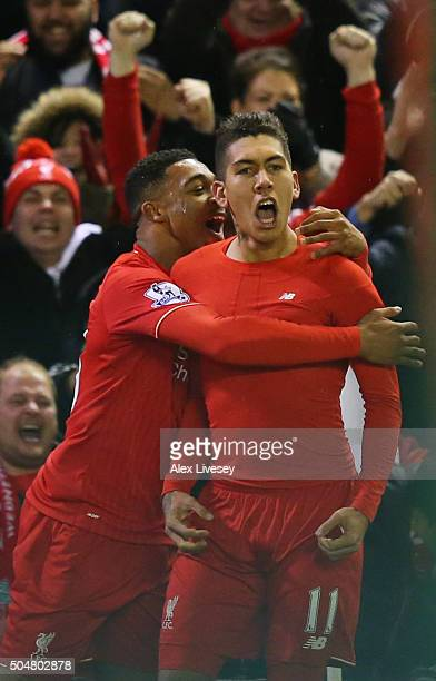Roberto Firmino of Liverpool celebrates scoring his team's first goal with his team mate Jordon Ibe during the Barclays Premier League match between...