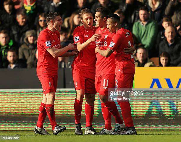 Roberto Firmino of Liverpool celebrates scoring his team's first goal with his team mates James Milner Lucas Leiva and Nathaniel Clyne during the...