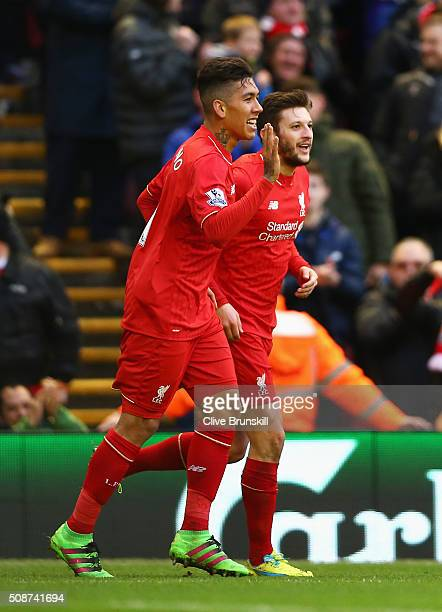 Roberto Firmino of Liverpool celebrates scoring his team's first goal with his team mate Adam Lallana during the Barclays Premier League match...