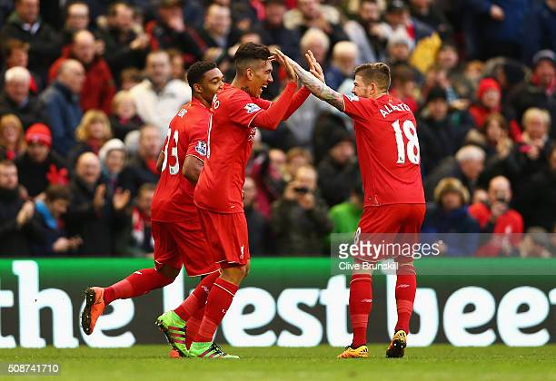Roberto Firmino of Liverpool celebrates scoring his team's first goal with his team mates Jordon Ibe and Alberto Moreno during the Barclays Premier...
