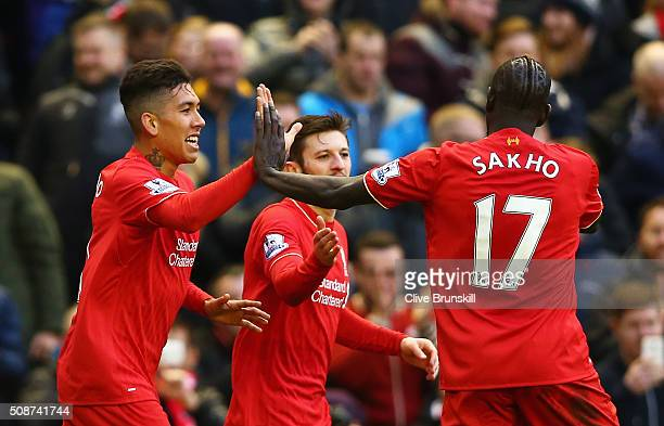 Roberto Firmino of Liverpool celebrates scoring his team's first goal with his team mates Adam Lallana and Mamadou Sakho during the Barclays Premier...