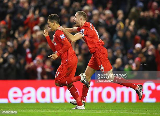 Roberto Firmino of Liverpool celebrates scoring his team's second goal with his team mate Jordan Henderson during the Barclays Premier League match...
