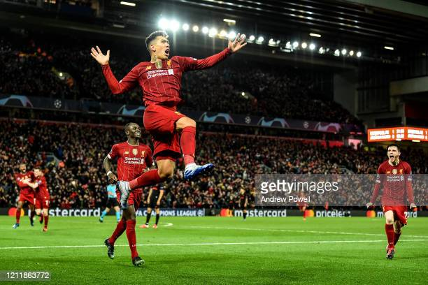 Roberto Firmino of Liverpool celebrates scoring Liverpool's second goal during the UEFA Champions League round of 16 second leg match between...