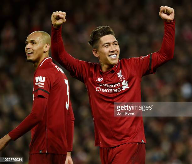 Roberto Firmino of Liverpool celebrates scoring the fifth goal from the penalty spot with Fabinho during the Premier League match between Liverpool...