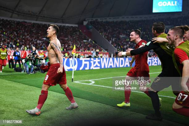 Roberto Firmino of Liverpool celebrates scoring the opening goal during the FIFA Club World Cup 2019 final match between Liverpool FC and CR Flamengo...