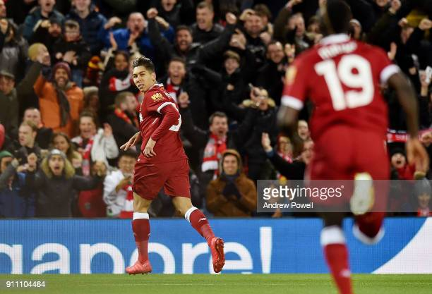 Roberto Firmino of Liverpool celebrates scoring the opening goal during The Emirates FA Cup Fourth Round match between Liverpool and West Bromwich...