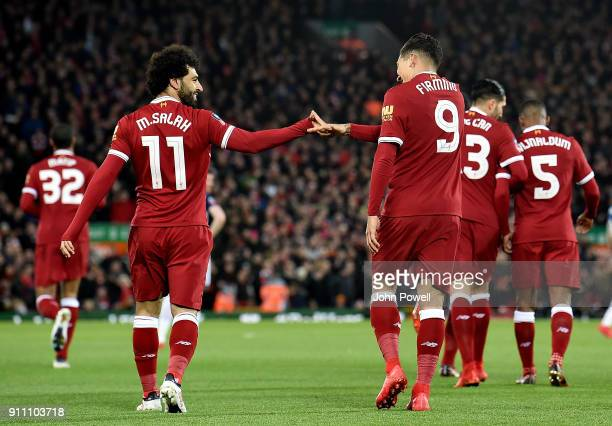 Roberto Firmino of Liverpool celebrates scoring the opening goal with Mohamed Salah of Liverpool during The Emirates FA Cup Fourth Round match...