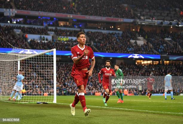 Roberto Firmino of Liverpool celebrates scoring the second goal during the Quarter Final Second Leg match between Manchester City and Liverpool at...