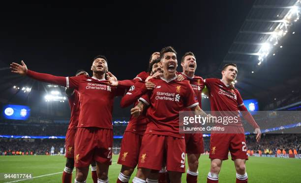 Roberto Firmino of Liverpool celebrates scoring the second goal with Alex OxladeChamberlain Virgil Van Dijk James Milner and Andy Roberton during the...
