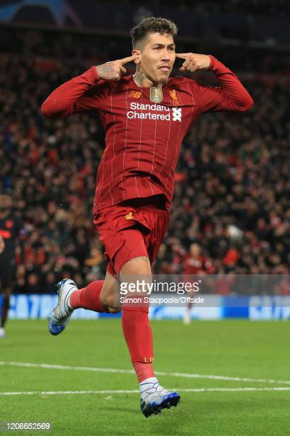 Roberto Firmino of Liverpool celebrates scoring their 2nd goal during the UEFA Champions League round of 16 second leg match between Liverpool FC and...