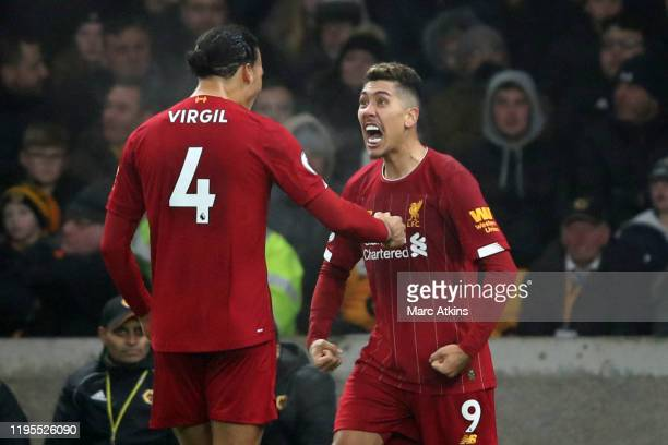 Roberto Firmino of Liverpool celebrates scoring their 2nd goal with Virgil van Dijk during the Premier League match between Wolverhampton Wanderers...