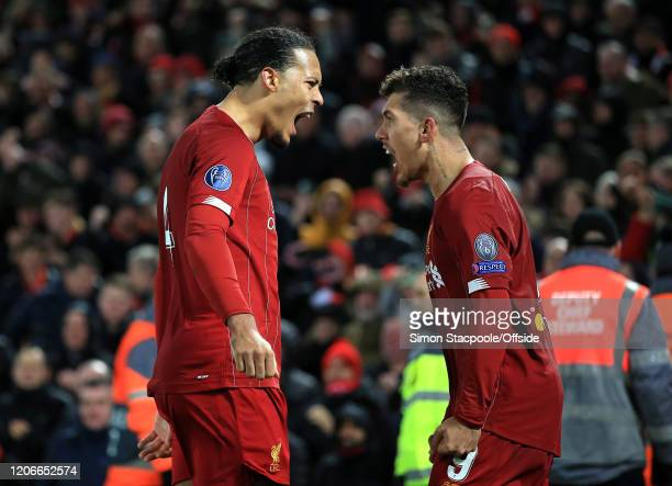Roberto Firmino of Liverpool celebrates scoring their 2nd goal with Virgil van Dijk during the UEFA Champions League round of 16 second leg match...